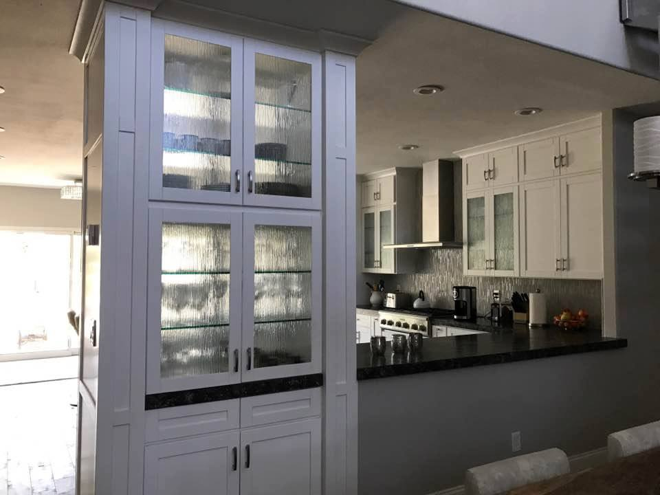 Picture of a cabinet in a kitchen.